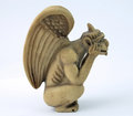 Notre dame gargoyle mini figurine of the from france Stock Photo