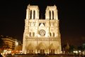 Notre dame by night the famous cathedral lit up in paris france Royalty Free Stock Images