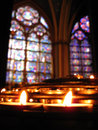 Notre Dame Prayer Candles & Stained Glass Royalty Free Stock Photo