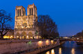 Notre Dame at the river Seine during twilight Stock Photo