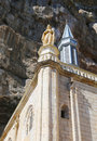 Notre dame statue on top of the notre dame de rocamadour chapel in episcopal city of rocamadour france wooden black madonna is Stock Photography