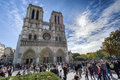 Notre dame tourist crowds of tourists swarming in front of catherdral in paris france during the month of september Royalty Free Stock Photo