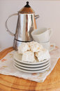 Nougat on plate with cups for coffee and coffee maker delicious sweets almond white plates floral pattern napkin Stock Photography
