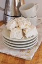 Nougat on plate with cups for coffee and coffee maker delicious sweets almond white plates floral pattern napkin Stock Images