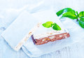 Nougat sweet with nut on white paper Royalty Free Stock Photo