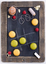 Noughts and crosses playing with traditional french macaroons Stock Photos