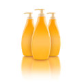 Nourishing body milk bottles blank yellow plastic with reflection Stock Photography