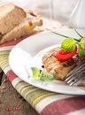 Nourishing steak on grill with tomatoes and bread a wooden table Royalty Free Stock Photography