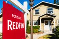 Nov 1, 2019 Santa Clara / CA / USA - Redfin sign posted in front of a house for sale; Redfin is a real estate brokerage whose Royalty Free Stock Photo