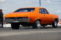 Nova napierville dragway canada june rear side view of orange chevrolet on the track at head up challenge event Royalty Free Stock Photography