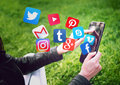 NOVI SAD, SERBIA- MAY 17, 2016: Facebook, Gmail, Instagram, Wikipedia, YouTube and other application icons flying out of a tablet Royalty Free Stock Photo