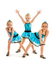 Novice girls tap dance trio three girl student dancers pose in blue recital costumes Royalty Free Stock Images