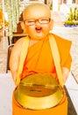 Novice holding alms bowl doll monk s Stock Photos