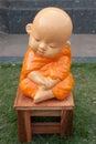 Novice monk statue made of mortar pasteur Stock Photos