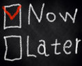 Now later tick red chalk board black Stock Images