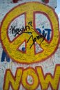 Now peace graffiti sign on the Berlin wall