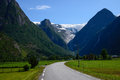 Nowegian country road a in norway with the glacier briksdalsbreen far away Stock Image