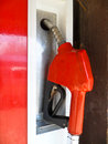 Nozzle closeup red oil station Royalty Free Stock Photography