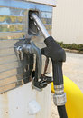 Nozzle on a fuel bowser and hose Stock Photos