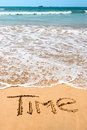 Nscription time on wet golden beach sand in front Royalty Free Stock Photography