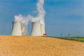 Nuclear power plant in temelin situated behind a ploouhed field freshly ploughed shot on sunny spring day Royalty Free Stock Image