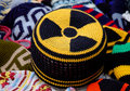 Nuclear radiation hazard sign on knitted hat Stock Images