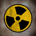 Nuclear symbol of danger on a stone wall Stock Photos
