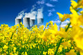 Nucler station in canola field power or energetics concept Stock Images