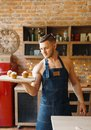 Nude husband in apron holds tray with dessert Royalty Free Stock Photo