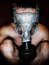Nude man with gas mask in a black background Royalty Free Stock Images