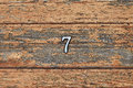 Number 7 on brown wooden wall Stock Photo