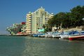 A number of boats moored along the coast on the background of the hotel, Pomorie, Bulgaria July 28, 2014 Royalty Free Stock Photo