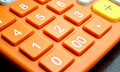 Number button on orange calculator Royalty Free Stock Photo