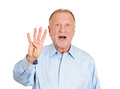 The number four closeup portrait of happy smiling senior mature man making times sign gesture with hand fingers isolated on white Stock Photography