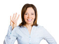 Number four closeup portrait happy smiling young woman making times sign gesture with hand fingers isolated white background Stock Image