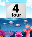 Number four and jellyfish underwater Royalty Free Stock Photo