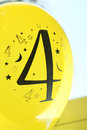 Number four is printed in black on the yellow balloon Stock Images