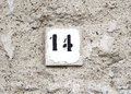 Number fourteen on old wall Royalty Free Stock Images