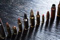 Number of large caliber ammunition different in one line on a dark textural wooden background studio shot Stock Photos
