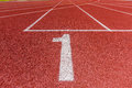 Number one on athletics running track Royalty Free Stock Photo