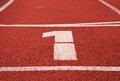 Number one white track number on red rubber racetrack texture of running racetracks in stadium small Royalty Free Stock Image