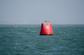 Number ten buoy a large red marker labelled at the entrance to poole harbour dorset Stock Photo