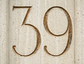 Number thirty nine a figure carved and gilded in a block of stone on the exterior of an office block in the city of london Royalty Free Stock Photo