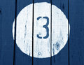 Number three on wooden blue toned wall. Royalty Free Stock Photo