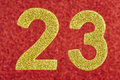 Number twenty-three yellow over a red background. Anniversary.