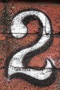 The number two stenciled on a brick wall great texture and unique wall is in bali indonesia southeast asia Royalty Free Stock Photos