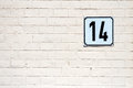 Number 14 on a wall Royalty Free Stock Photo
