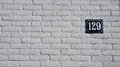 Number 129 on white wall Royalty Free Stock Photo
