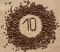 Numbers from coffee beans on burlap background Royalty Free Stock Photo