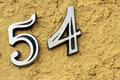 Numbers five and four in a wall Royalty Free Stock Photo